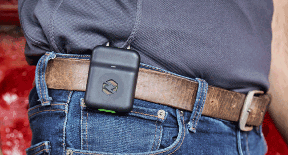 rapid overmolding Spot-r wearable device produced by Protolabs worn by construction worker attached on belt loop.