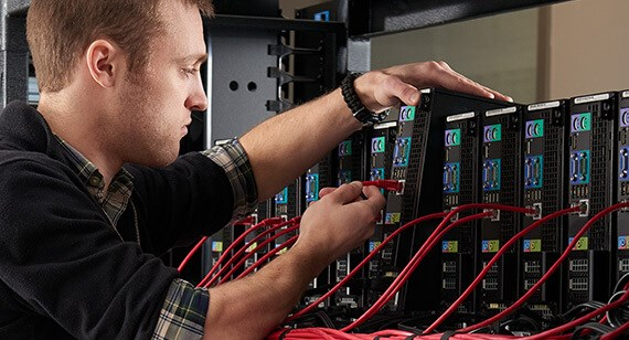 IT technician works on computer cluster