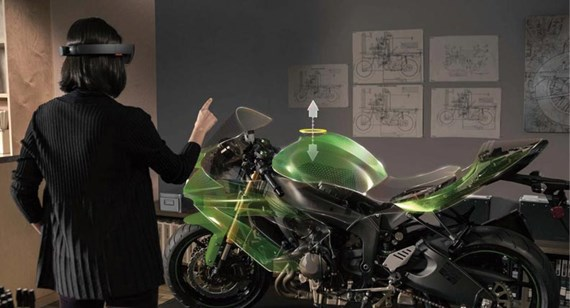a designer uses augmented reality on motorcycle