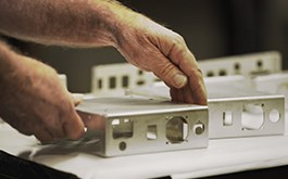 technician handling sheet metal parts from rapid manufacturing