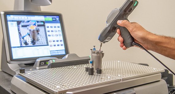 3d printing technician measures direct metal laser sintering part with CT scanning