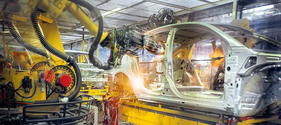 aluminum car chasis being assembled in automotive digitlal manufacturing factory
