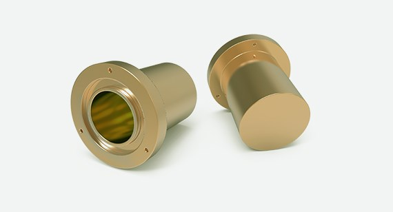 A cylindrical brass component turned on a lathe