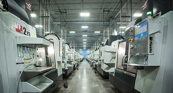 A row of CNC mills at Protolabs