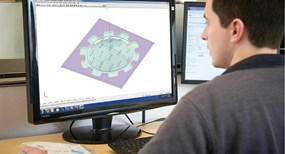 applications specialist working on CAD model