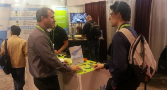 Protolabs employee talks with trade show guest