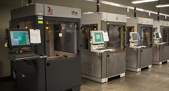 A row of industrial stereolithography machines